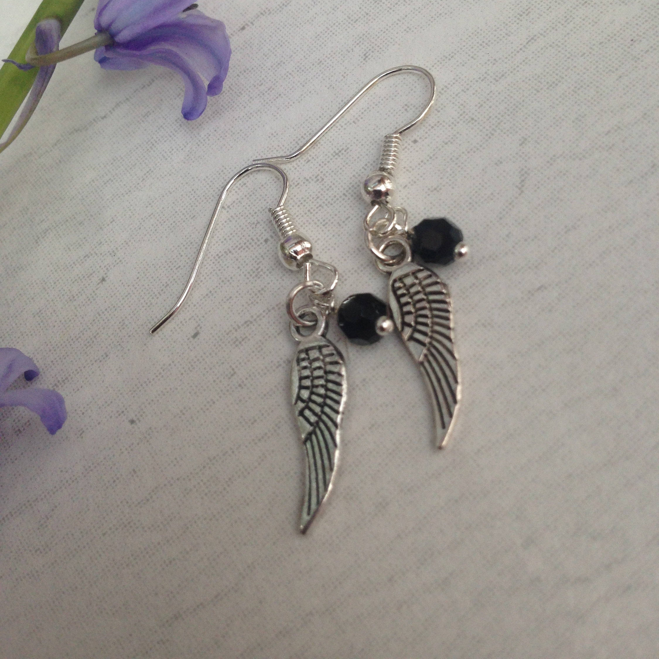 Small Antique Silver Tibetan Wing drop earrings with small black crystal bead.