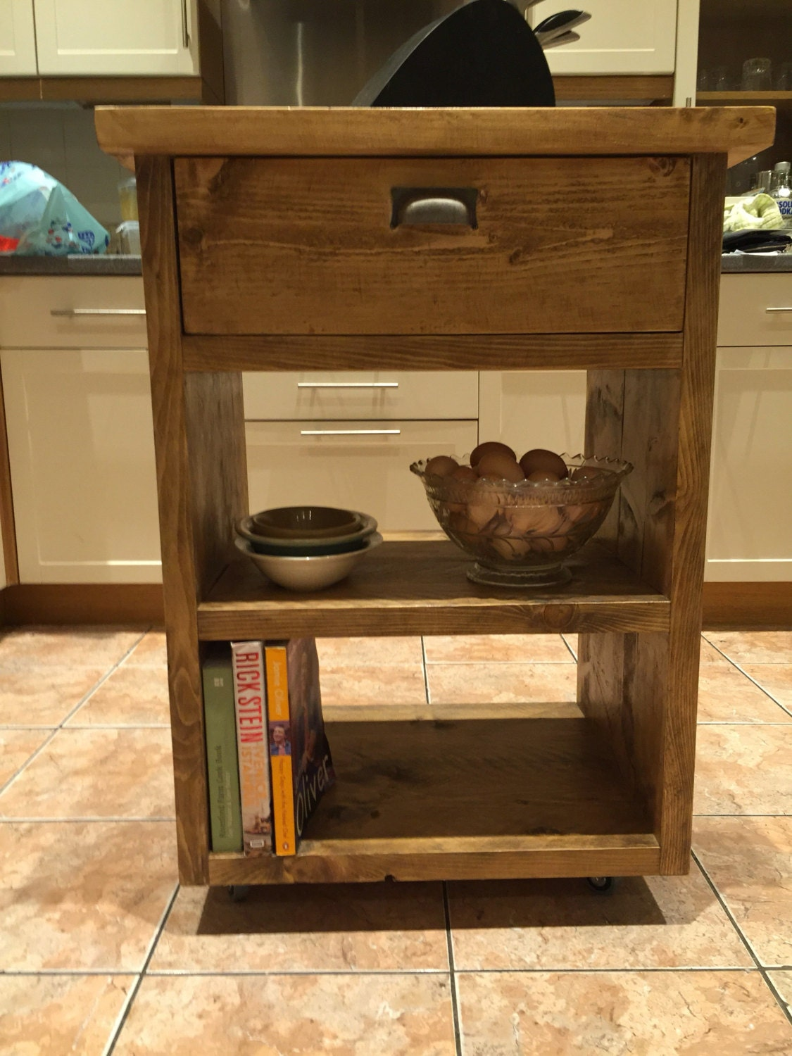 Handmade kitchen island unit crafted from recycled scaffold planks.