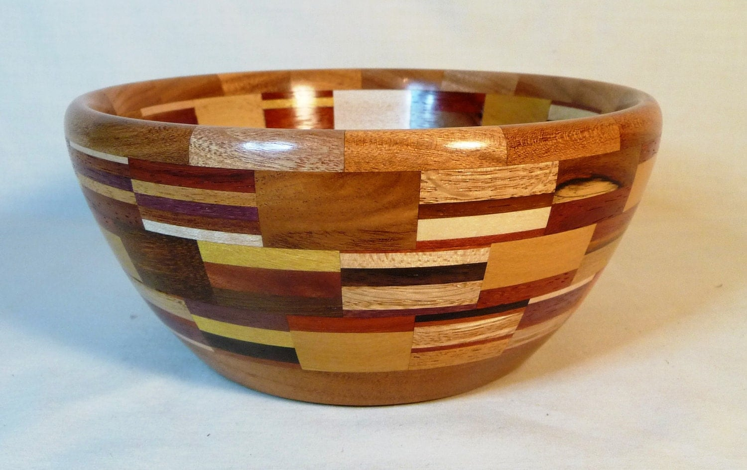 Segmented bowl with more than 30 domestic and exotic hardwoods. - HWRWood