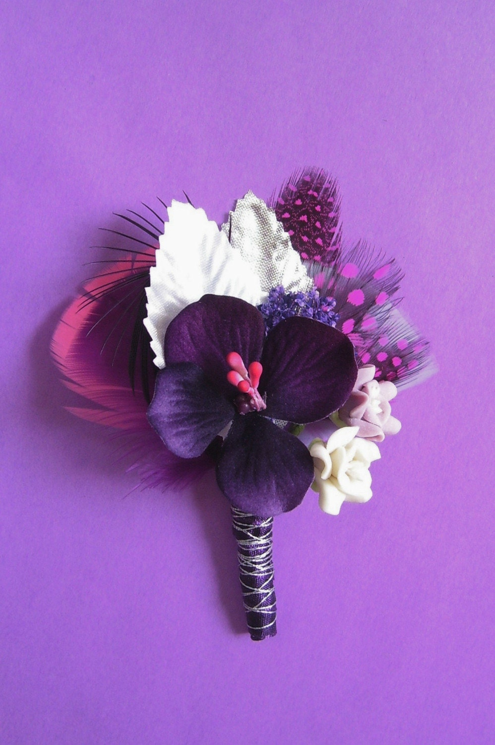 with a dark purple ribbon with silver metallic floss wrapped around