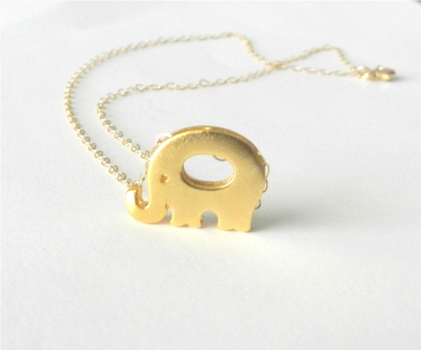 Tiny elephant necklace in gold, lucky little elephant, delicate modern jewelry