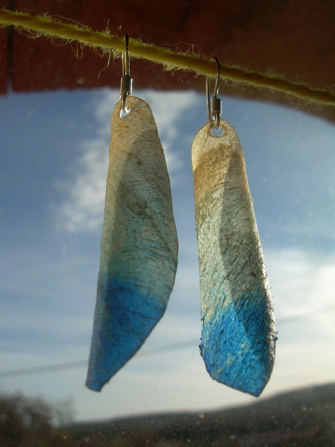Earrings made with genuine DEER parchment.