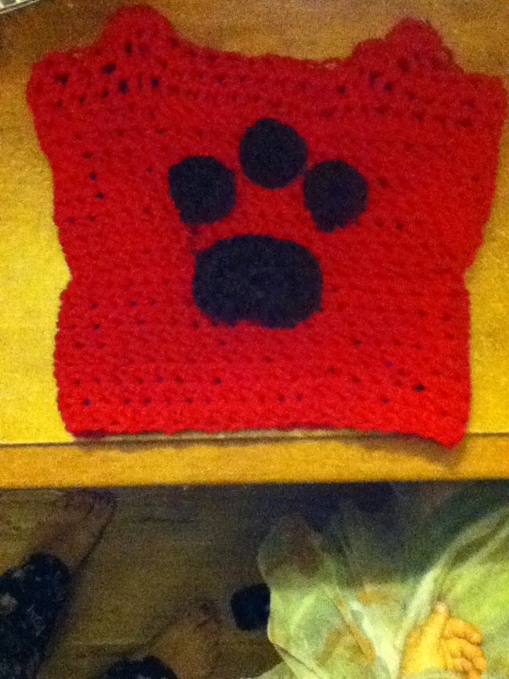 Super Cute Doggie Sweater with a paw crocheted on it.