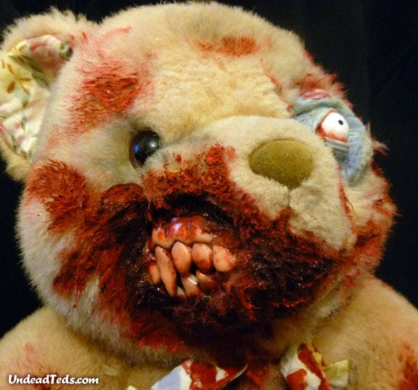 UnDeadTed with fur loss around eye & partially eaten face.