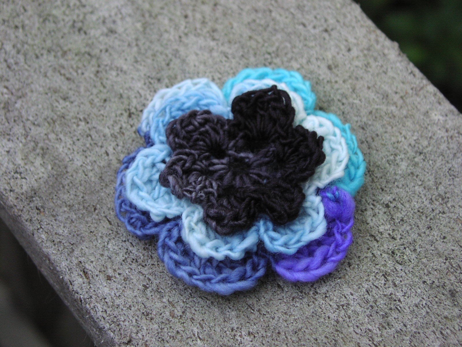 Bruise, crocheted wool flower brooch, black blue and purple, ONLY ONE