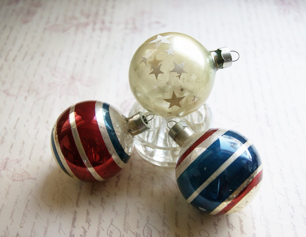 Red white and blue christmas ornaments in stars by