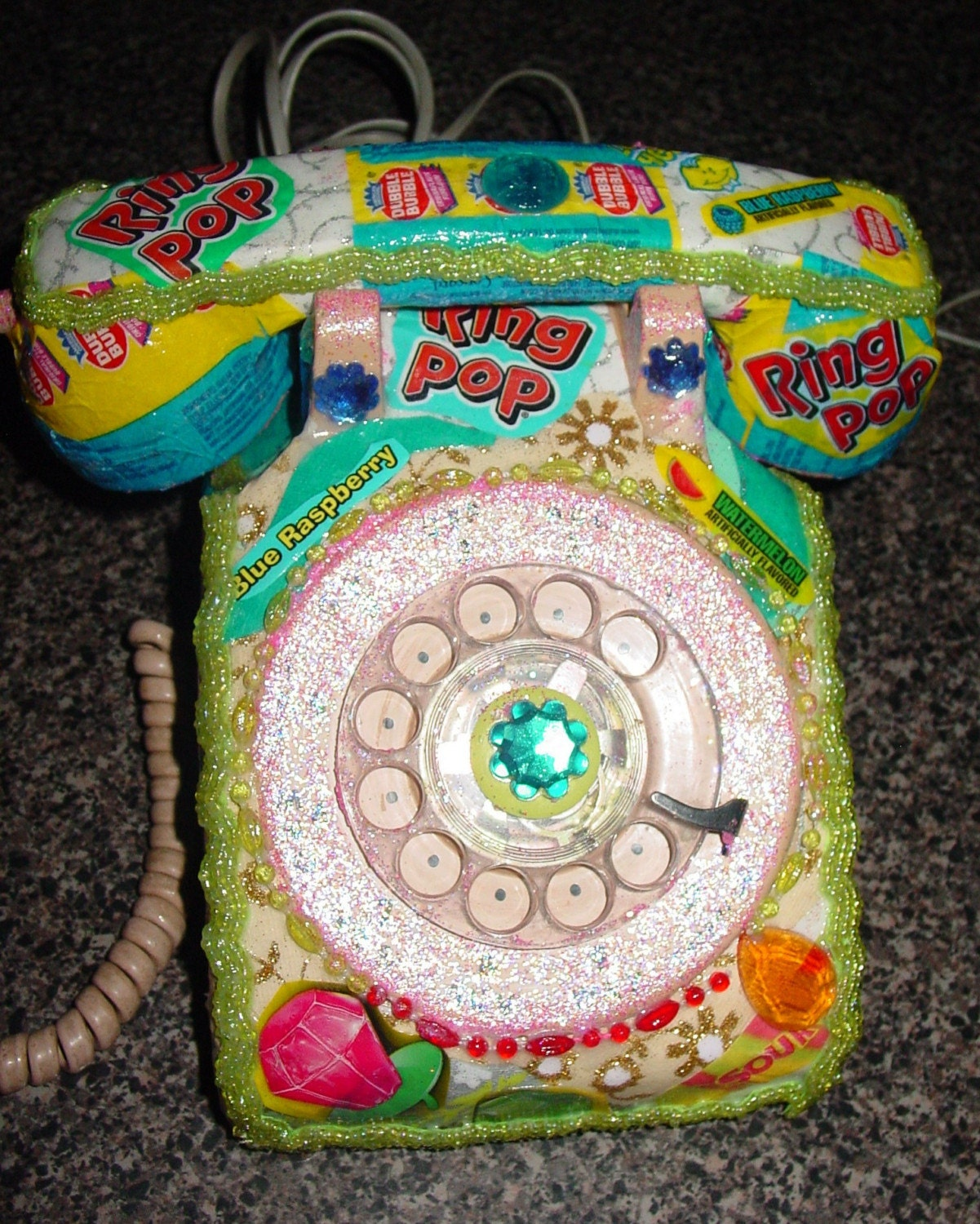 recycled vintage dial phone by C.Reinke RING POP candy wrappers.Kitsch at its best