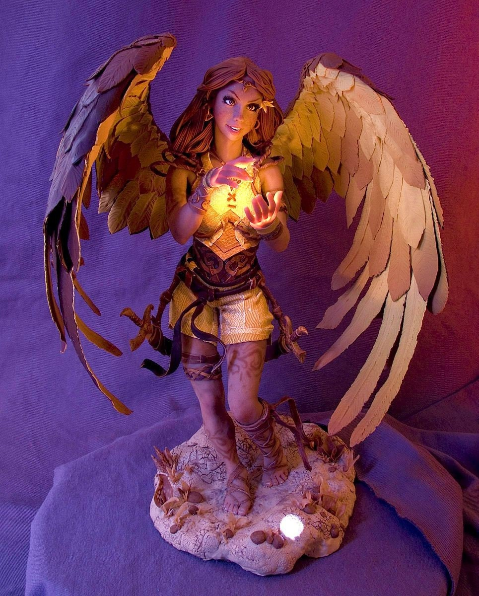 14 inch female figure with wings and illuminated hands