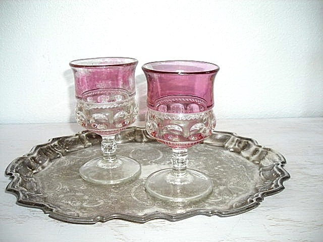 soft cranberry glass goblets - rose colored pressed glass vases - shabby chic cottage beach decor - faded ruby glass hollywood regency - shesitsbytheseashore