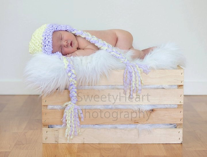 Newborn crochet earflap with tails hat in yellow and purple