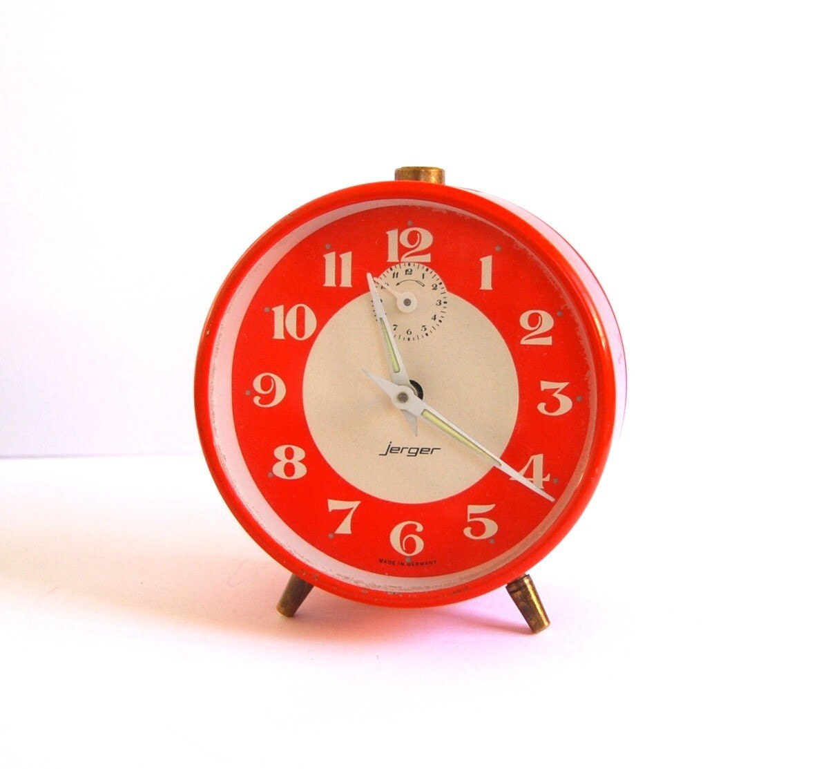 Vintage orange Jerger alarm clock made in Germany by spacejam from etsy.com