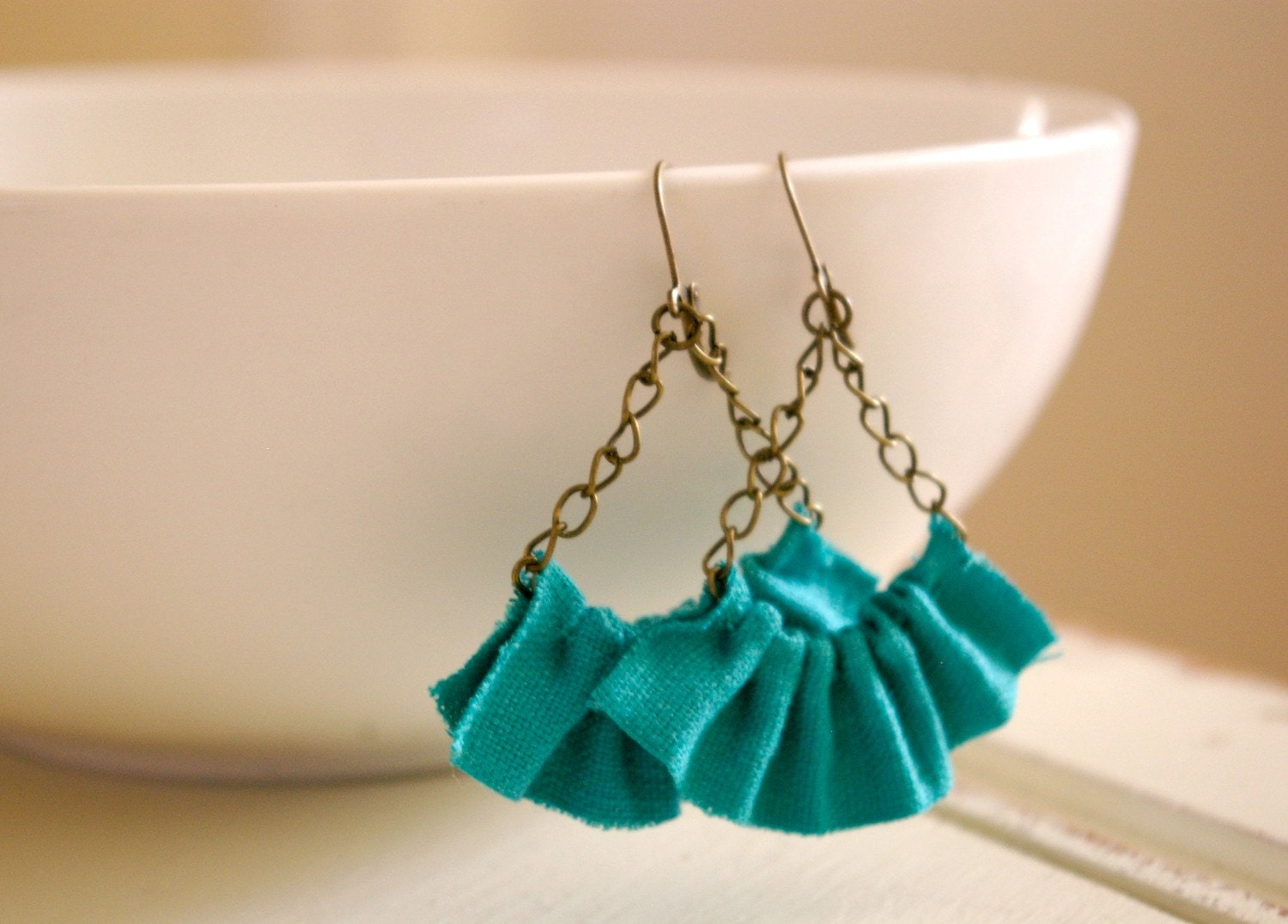 linen ruffle earrings in seafoam green. available in several other colors.