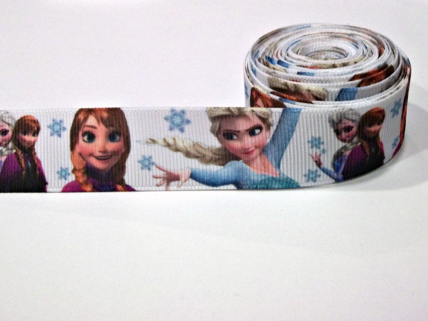 http://www.etsy.com/listing/177792601/78-wide-frozen-themed-ribbon-1-yard-anna?ref=sr_gallery_16&ga_search_query=disney+frozen+&ga_order=most_relevant&ga_ship_to=US&ga_search_type=supplies&ga_view_type=gallery