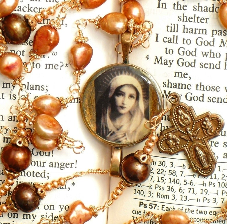 Handmade copper wire wrapped five decade Catholic Rosary featuring the Blessed Mother Mary center