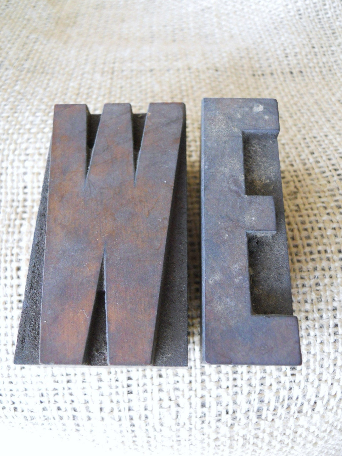 vintage wood block letters from printshop WE or ME
