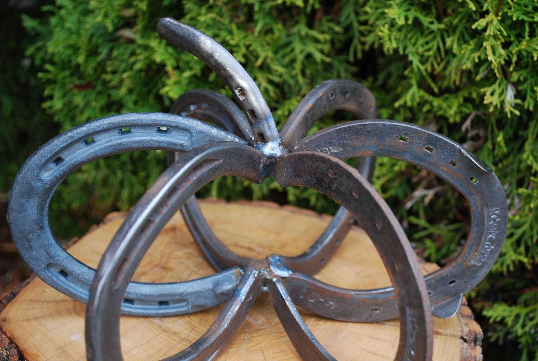 welded horseshoe art. 6 horseshoes make up the base,