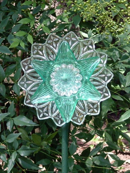 Garden art flower suncatcher made with repurposed glass.  Aqua glass flower suncatcher.