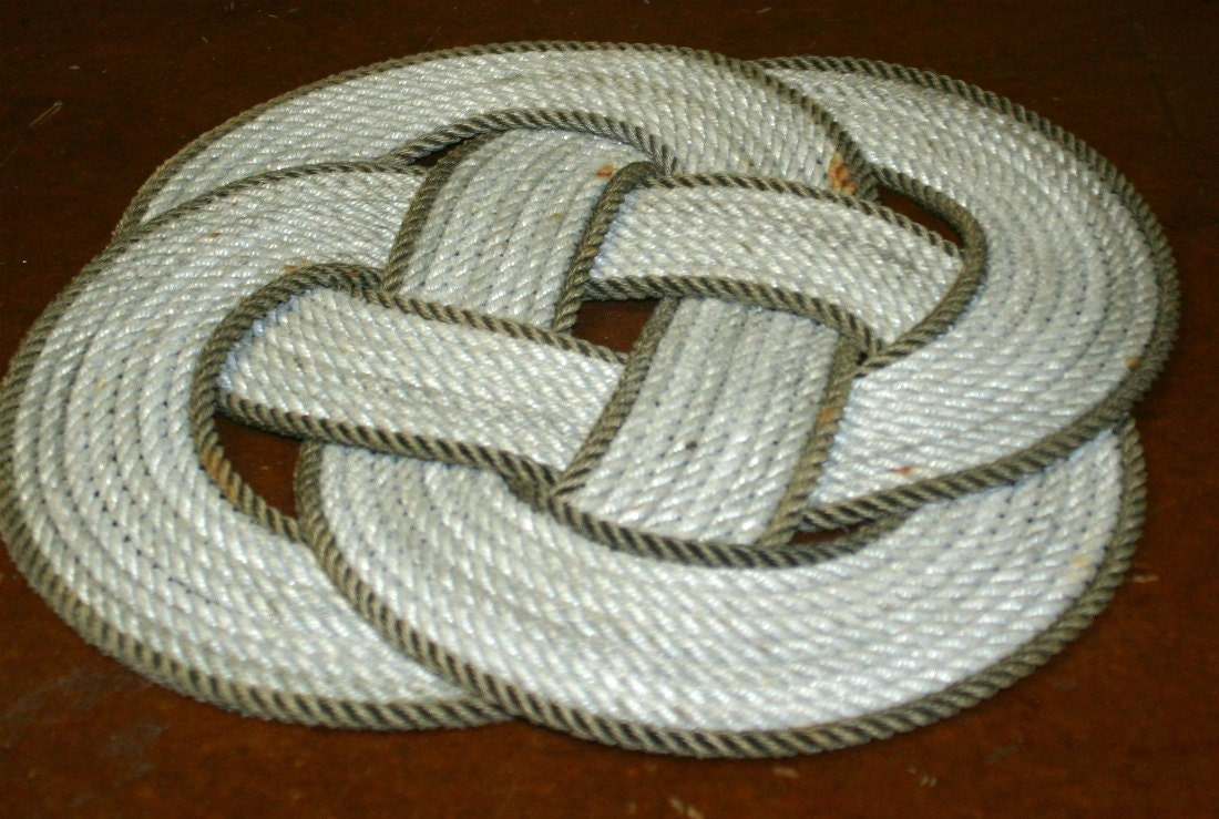 How to make your own rope rug nautical rope by for Rope carpet