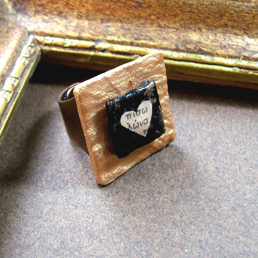 Gold and black ring with heart