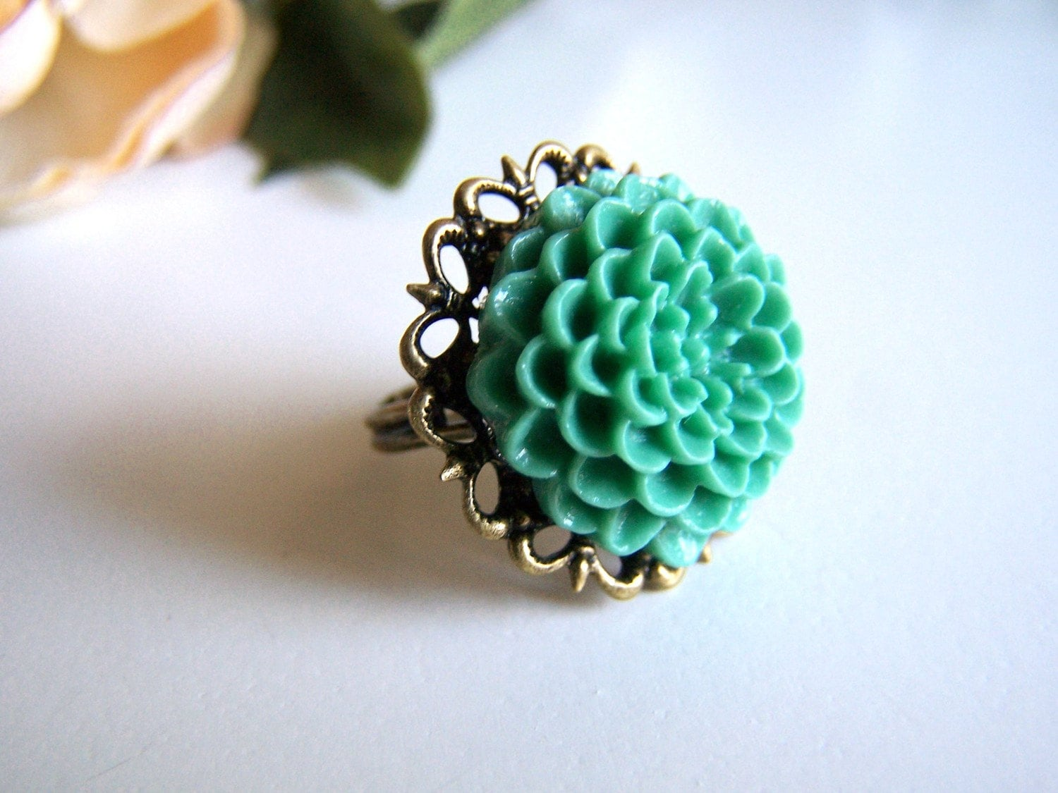 the teal daphne ring.