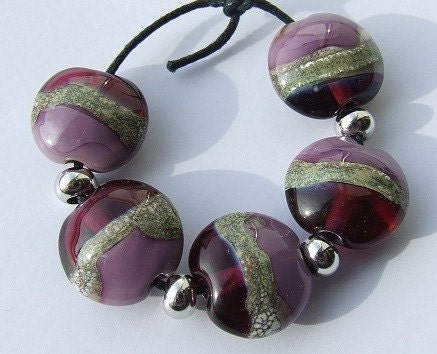 lampwork beads in luscious tones of heather and berry, with a silvered ivory detail