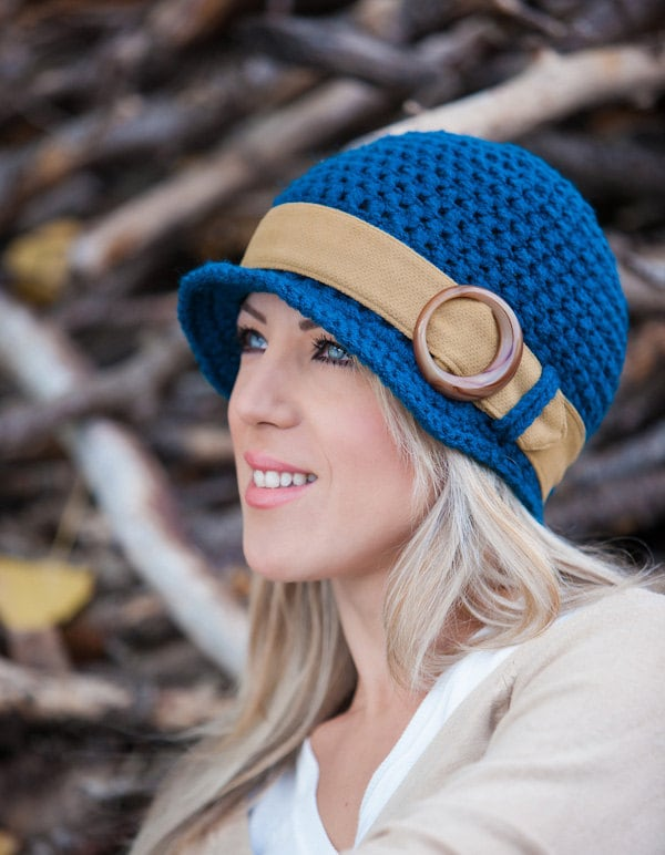 Crocheted Woman's Hat with Brim in Teal colour with a Beige Band.