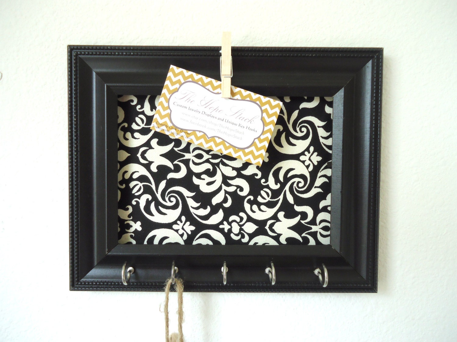 Unavailable listing on etsy for Picture frames organized on walls