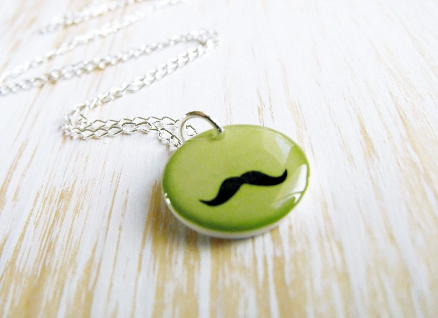 Mustache on lemon green. Delicate necklace.