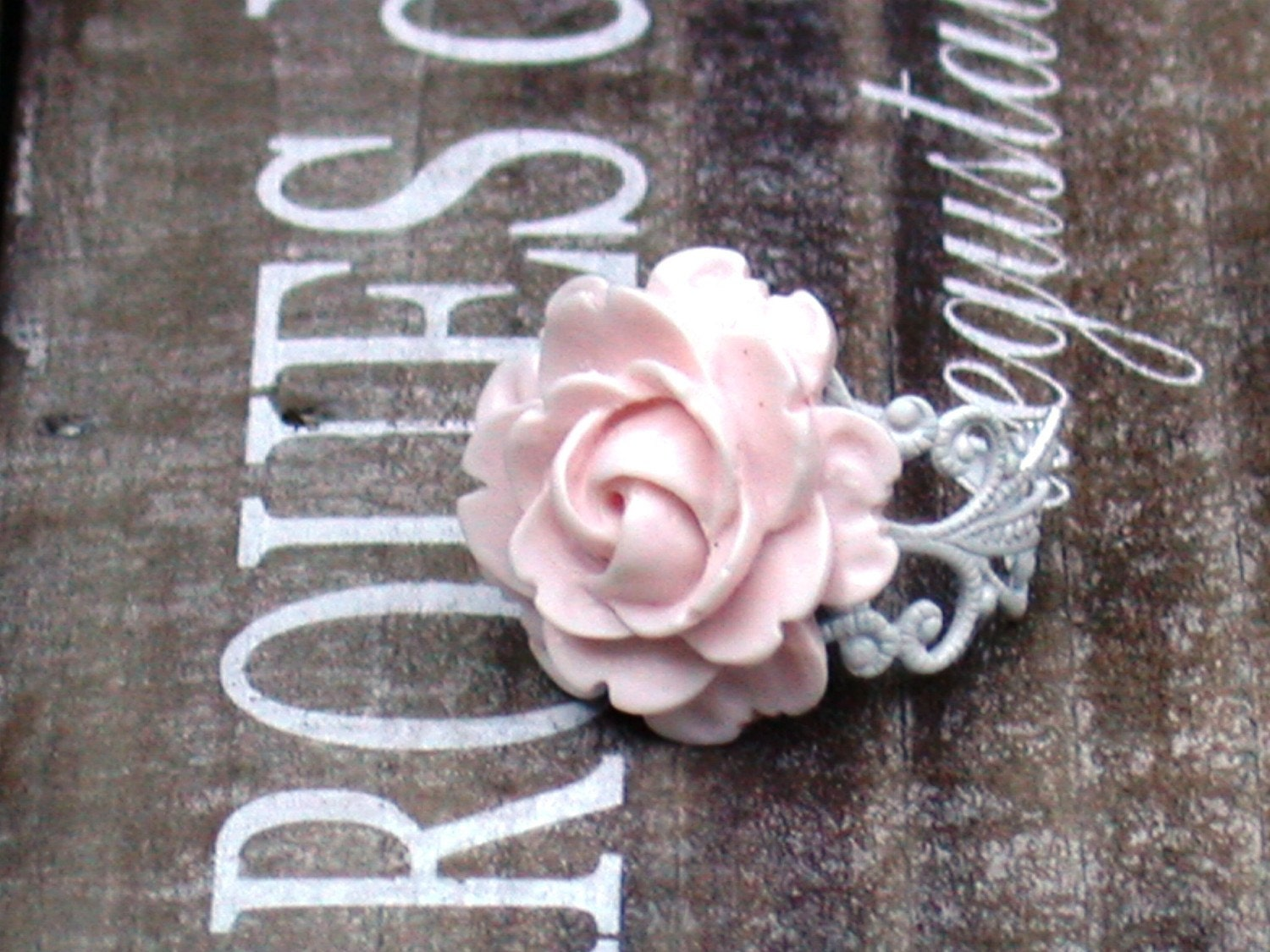 White Vintage Ring And A Pale Pink Rose