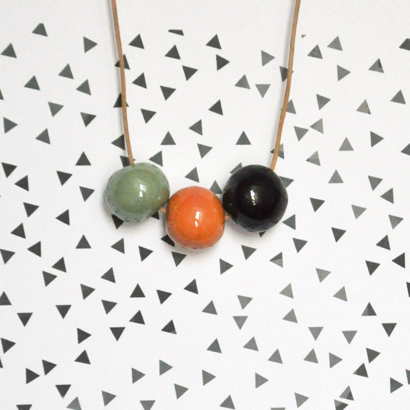Ceramic bead necklace .  Handmade ceramic bead / Pale green, orange and black - oelwein