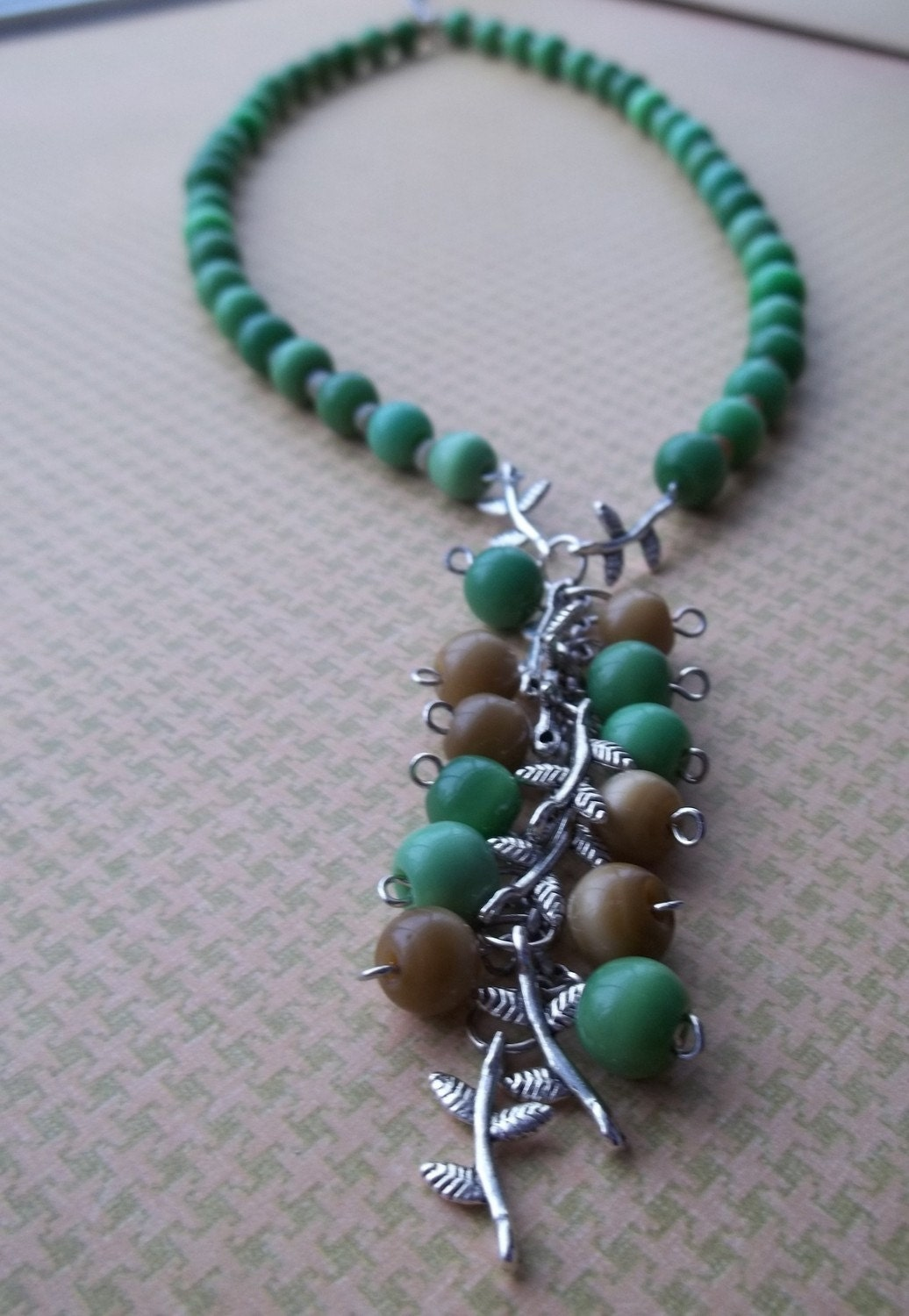 Green and Brown Beaded Necklace with Silver Bamboo Leaf Cluster