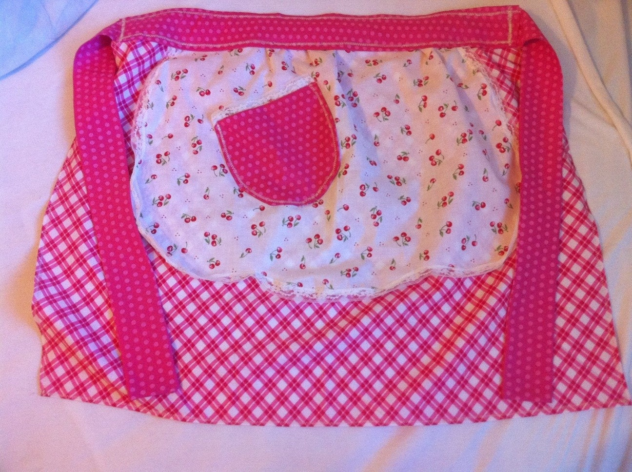 Cherry half apron vintage style with cherries on gingham with polka dot band.