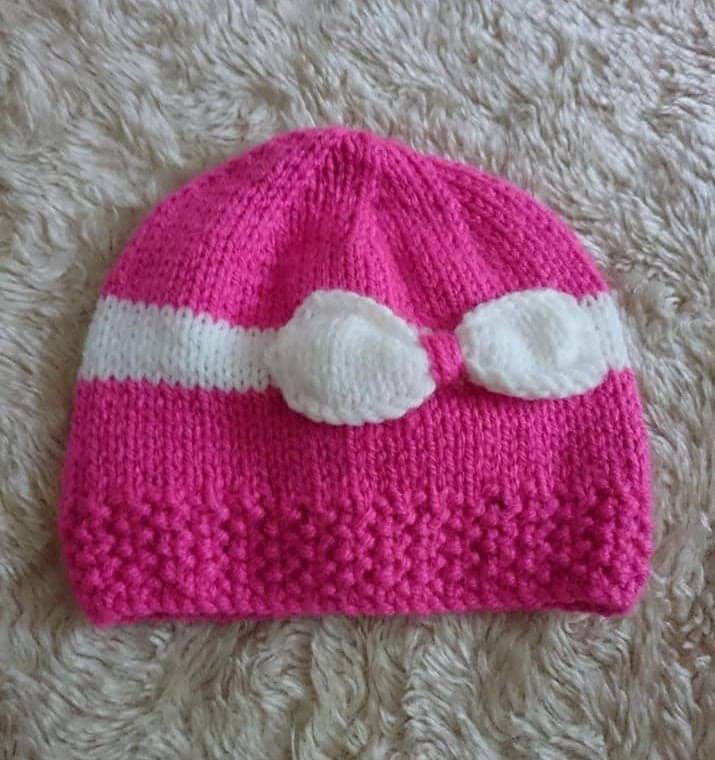 Hand knitted baby girls beanie hat