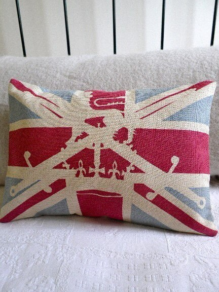 union jack flag with British military lion, crown and sword overlay cushion