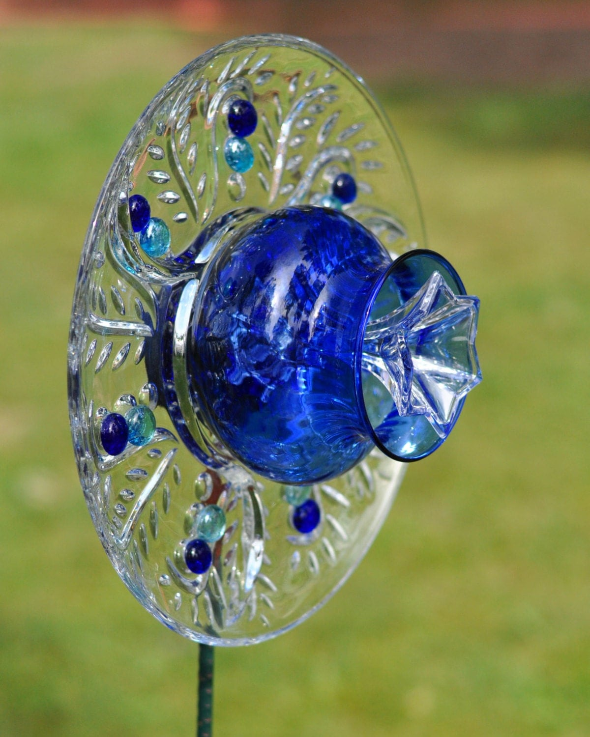 Items similar to repurposed glass garden flower wall art for Garden art from old dishes