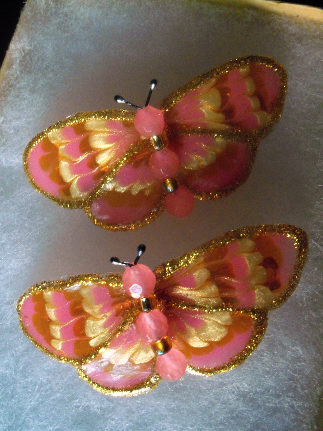 pair of small pink butterfly barrettes
