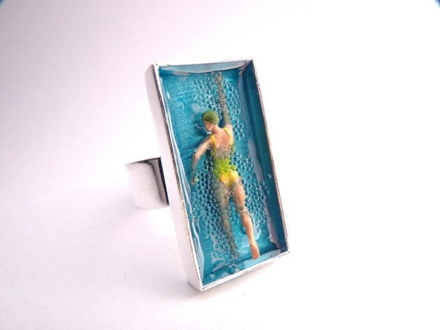 Swiming in the sea ring  girl in yellow  by Auka on Etsy from etsy.com