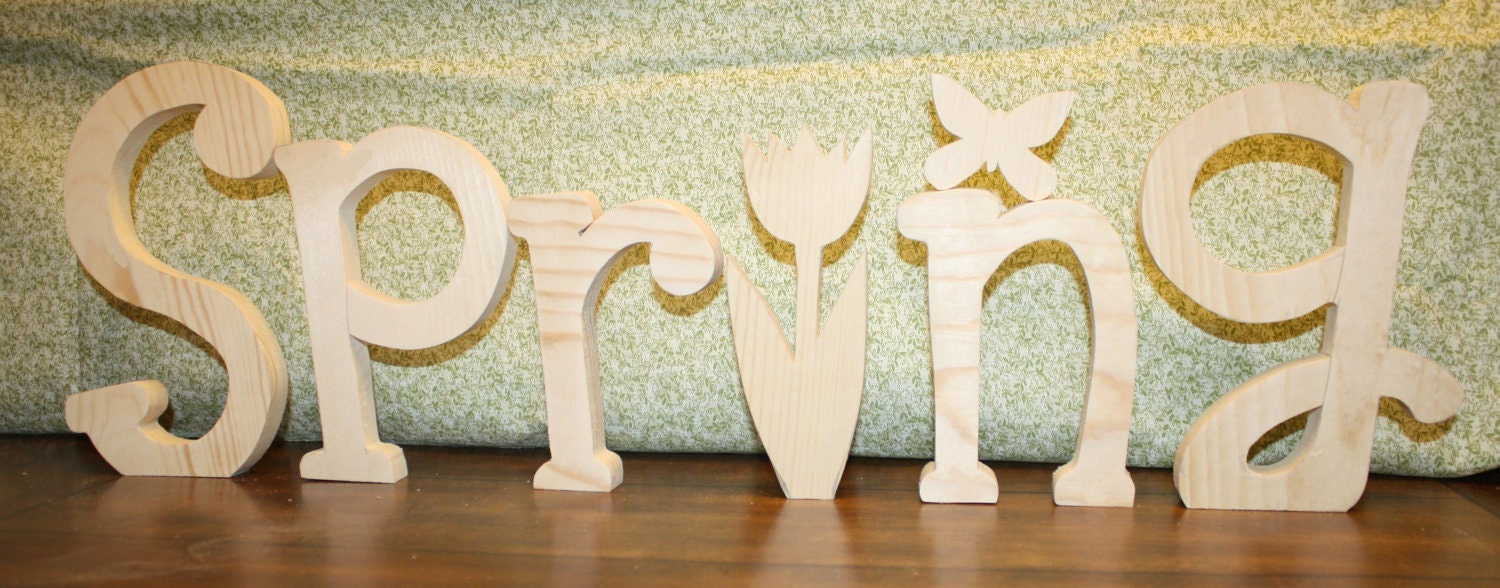 """UNFINISHED SPRING wood letters with a tulip for the """"I"""" and a butterfly as an extra bonus."""
