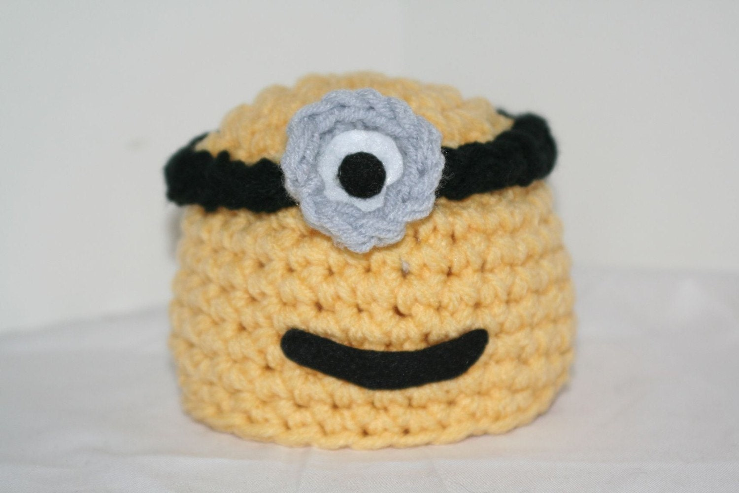 Newborn baby size handmade crocheted character hat - inspired by the Minions - can also be used as a photo prop
