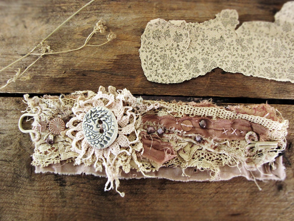 Dust of ages - salvage textile wristcuff - vintage lace - ceramic button detail