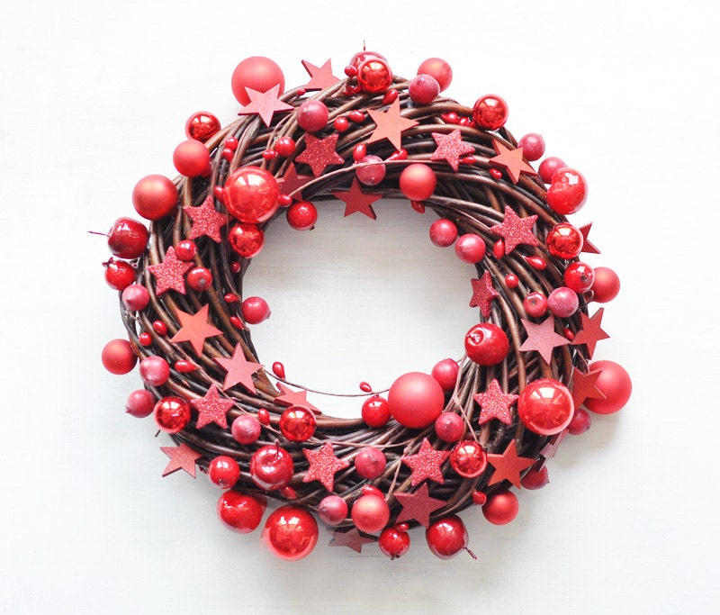 red apple, berry, and star christmas wreath with twigs
