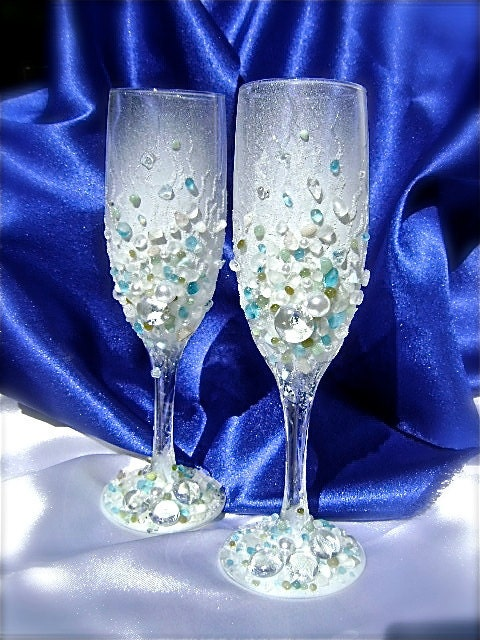 A beautiful pair of hand decorated wedding champagne glasses