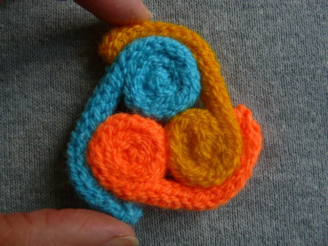 Hand knitted triskele brooch  celtic knitted brooch   bright colours triskelion brooch   triskele brooch