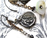 White. Religious Medal and Opalecent Drop Earrings.