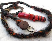 Sale. Source World. Men's Coral And Recycled Sari Yarn Choker.