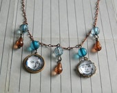 Unique Little Man Necklace on Copper Chain With Vintage Illustrations and Blue and Brown Beads.