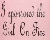 Chocolate font on 100 percent cotton, light pink, fitted Tshirt I SPONSORED THE GIRL ON FIRE