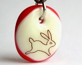 Bunny on Vanilla and Red. A fused glass pendant necklace.