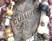 Gulliver.  Antique Tag Necklace.
