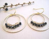 Double hoops with black garnet earrings